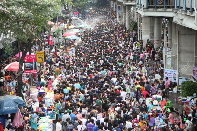 27928812-BANGKOK-APRIL-13-Stream-of-water-over-the-crowd-of-people-during-celebrating-the-traditional-Songkra-Stock-Photo.jpg